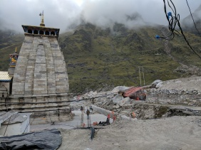 Side View of Kedarnath Temple with the red rock that protected the temple in 2013