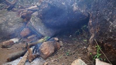 bamboo chicken being cooked near katika waterfalls