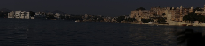 panaromic view of city palace and taj hotel from the boat