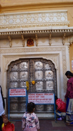 silver door of temple inside amber fort in jaipur