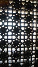 stonework lattice windows inside udaipur palace