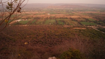 view of fields from the eastern gate at chittorgarh