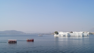 view of taj hotel in the middle of pichola lake