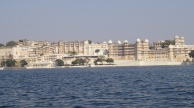 view of udaipur city palace from the boat in lake pichola