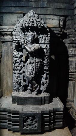 Idol of Krishna with broken flute (Left side) inside Keshava Temple in Somanathpur